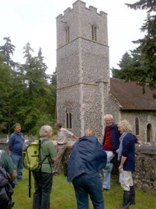 Bob Carr interpreting the use of flint on Santon Downham church as part of the 6th July training day. Photo by Alan Spidy